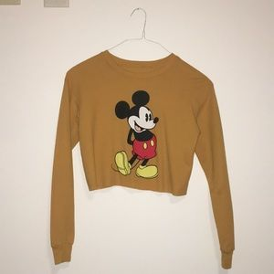 Orange Mickey Mouse cropped sweatshirt.